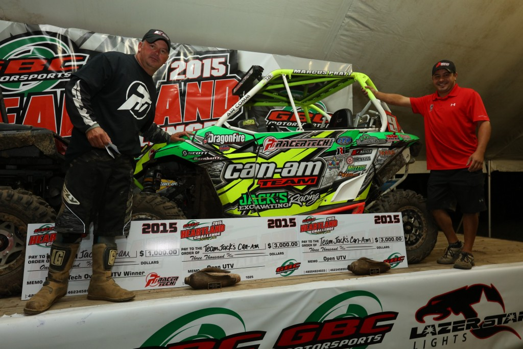 Can-Am Maverick 1000R racers and brothers Mouse and Marcus Pratt (right) celebrate their UTV 1000 (Pro) class victory and UTV overall win on the podium at the 2016 GBC Heartland Challenge in Carlisle, Iowa.